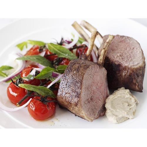Roasted lamb racks with tomato and mint salad recipe. Roast lamb is an all-time family favourite, and for good reason. This delicious version will satisfy the gluten-free, paleo, low-carb, or just plain hungry.  #ModernAustralian #Meatdish #Lamb #Glutenfree #Dinner #Lowcarb