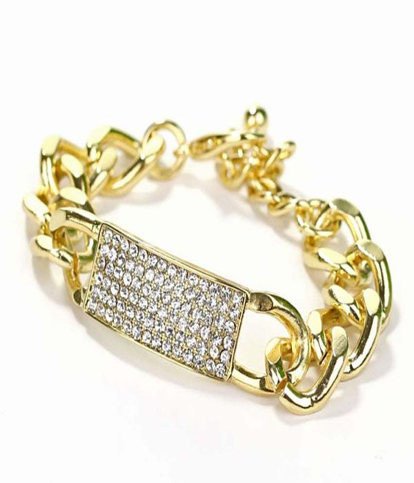 MIKAELA MILITARY GOLD CHAIN BRACELET  We be blingin'. Stealing design attributes from the military I.D. tag, the Mikaela bracelet features a pavé rhinestone plate and chunky irregular chain in gold-plating with a clasp fastening. The sparkle that you need for that L.B.D.
