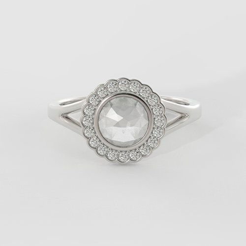 The Diana features a rose-cut center stone, creating a unique vintage look that will garner the attention of all who see. The center stone is surrounded by a dainty scalloped halo and supported by a split shank.
