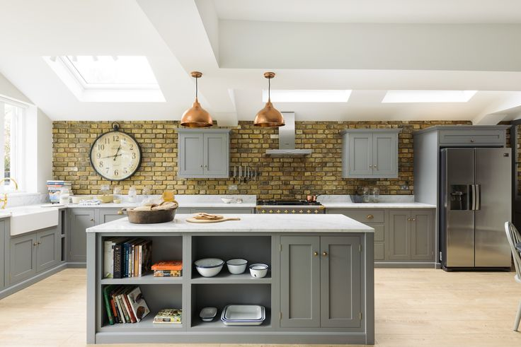 A beautiful family Shaker kitchen in south London painted in Lead with brass handles and Carrara marble worktops