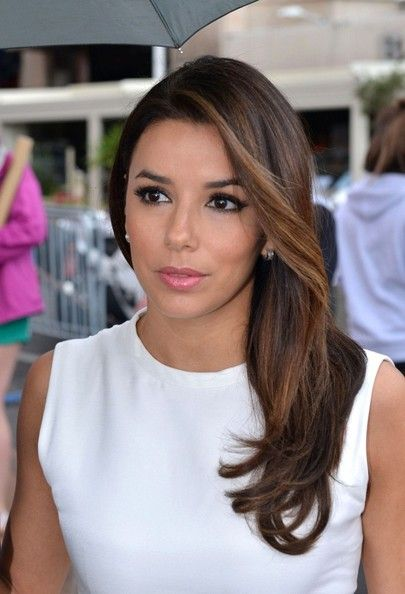 Long Side Part  Eva Longoria wore her silky tresses in a straight and side-swept style.  Eva Longoria Pink Lipstick  Eva Longoria added a touch of pretty pink lipstick topped with a hint of sheer shimmery gloss.