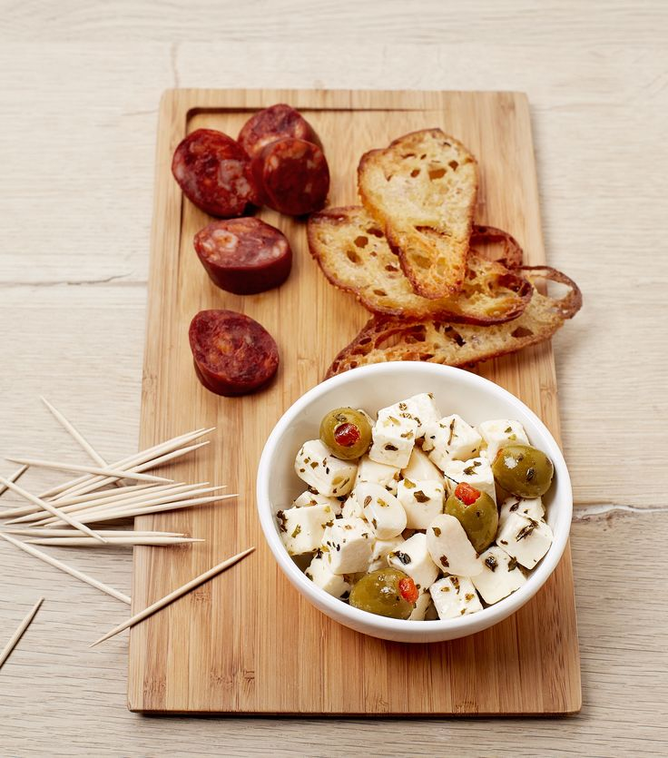 Summer aperitif with white cheese and olives