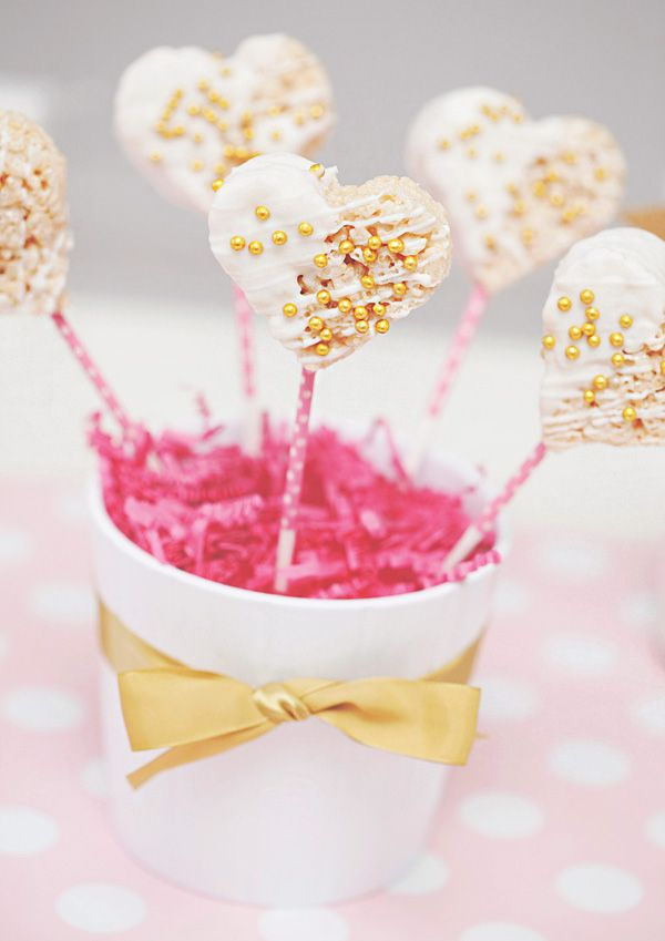 Rice Krispie Treat pops - dipped in white chocolate & sprinkled with gold pearls. For a girl baby shower