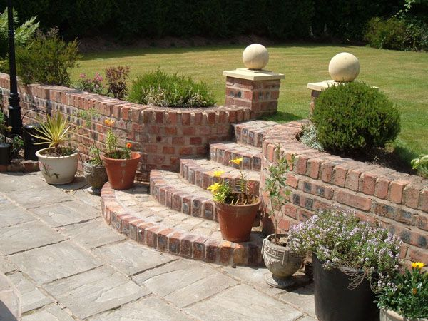This is perfect - only without the pillar toppers? retaining wall with curved steps - St Helens Brickwork