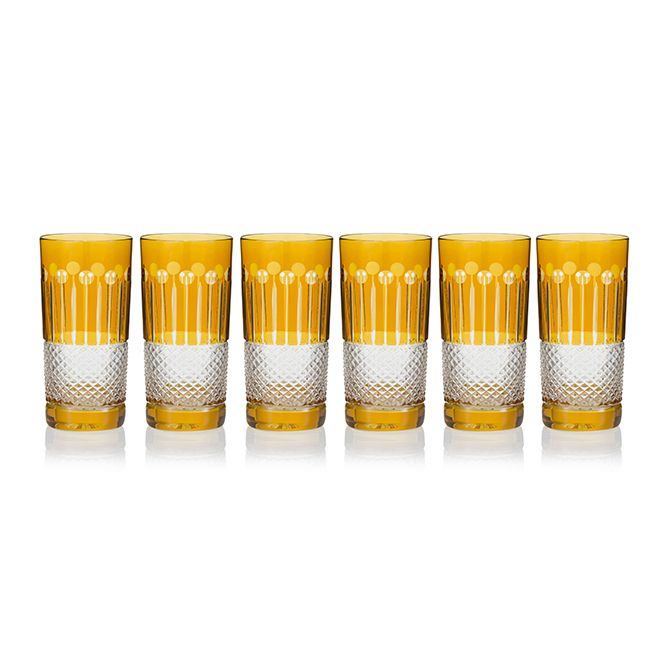 """The amber gold range includes stemware and barware in set of six. The range invites the curation of modern """"friends and family"""" drinking experience, which interplays between proportion, weight and size. Representing handmade, 24% lead crystal, these amber cocktail glasses will accessorise both traditional and modern interiors."""