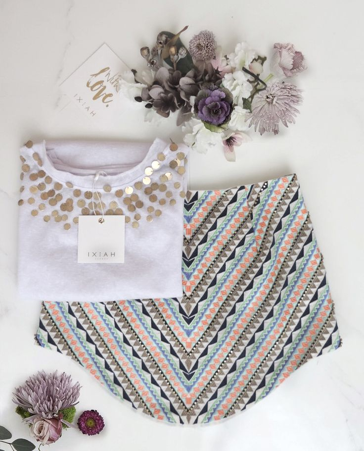 IXIAH FLAT LAY // Flowers surround the Tremble Beaded Tank & Highness Embroidered and Beaded Skirt.  Knit tee, embroidery, colour, tank top, gold, beading, embellished, fashion, style, street style