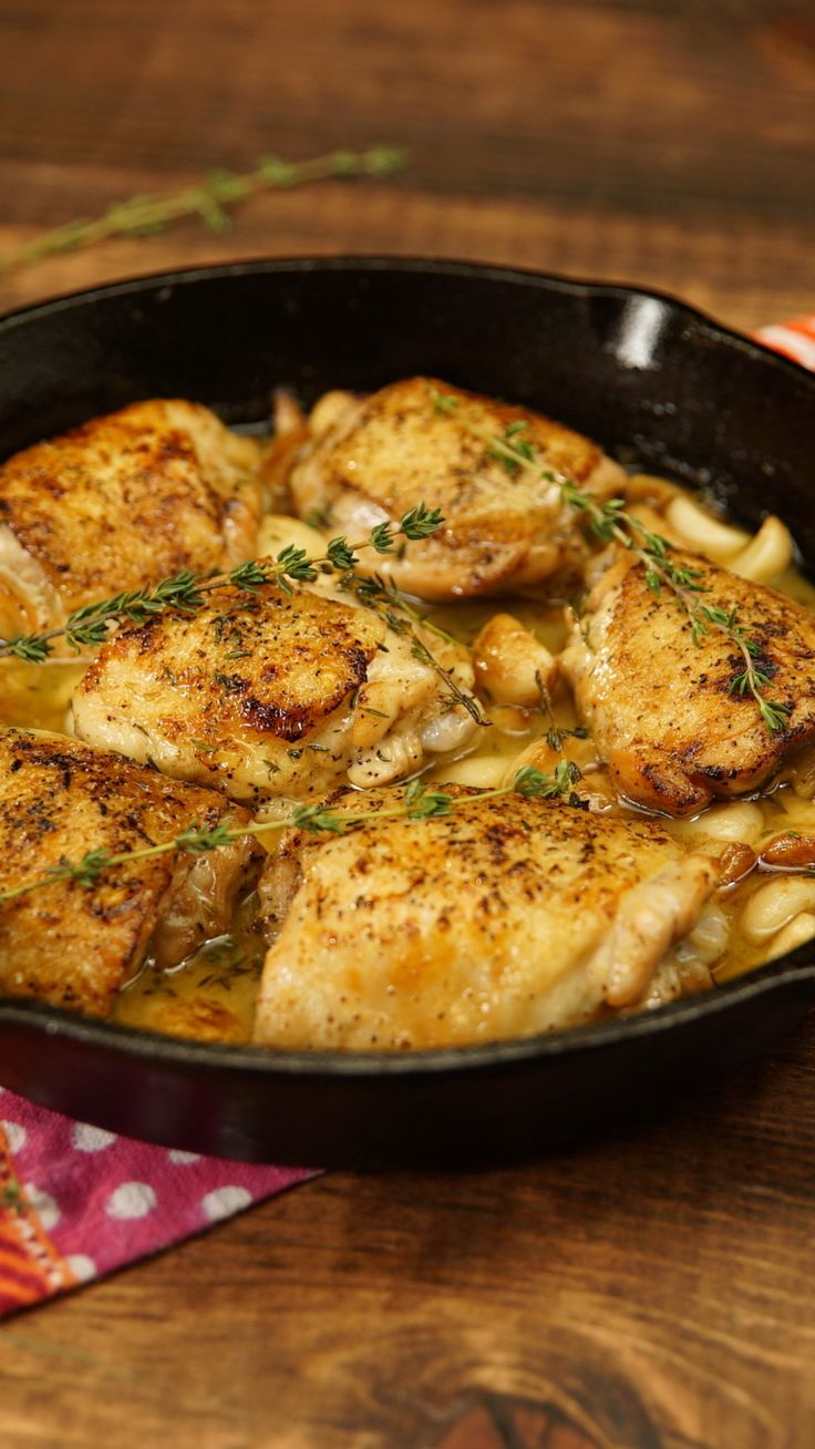 Recipe with video instructions: This tasty low-effort, high-reward chicken dish is so worth the garlic breath. Ingredients: 6 chicken thighs, with bone and skin, Salt and pepper, to taste, 3 Tbsp clarified butter, 40 cloves garlic, peeled, Several sprigs of thyme, 1 cup white wine, Mashed potatoes, to serve