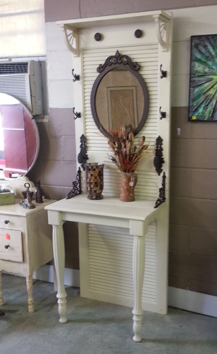 Here is another use for an old shutter door. We converted it a foyer/hall tree with table top. Perfectly repurposed the Just Repurposed way. www.justrepurposed.com