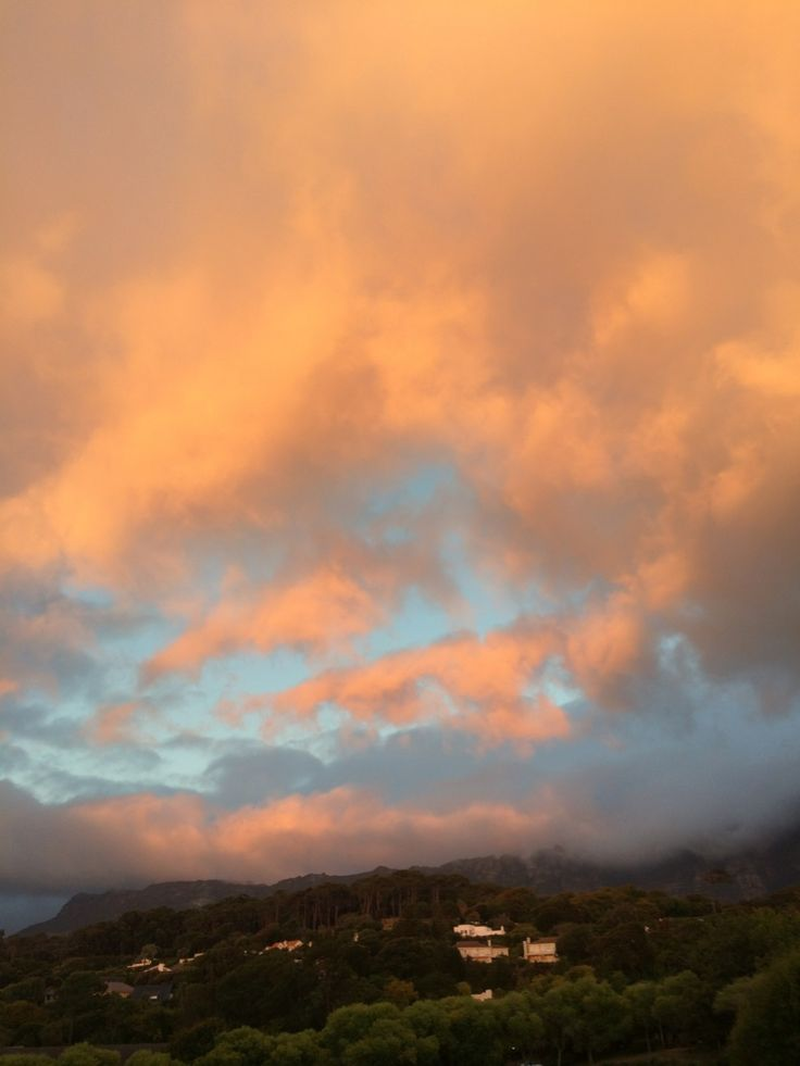 Marshmallow coloured morning clouds over Cape Town.