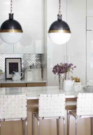 Make a Splash With Metal:  miniature stainless steel tiles for the backsplash, which gave an industrial edge to the Calcutta countertops and white lacquer cabinetry in her kitchen. A twist on traditional subway tile, the metal is modern and easy to keep clean.  http://www.hgtv.com/kitchens/dreamy-kitchen-backsplashes/pictures/index.html