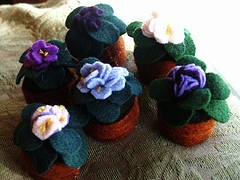 African violet bottle cap pincushion