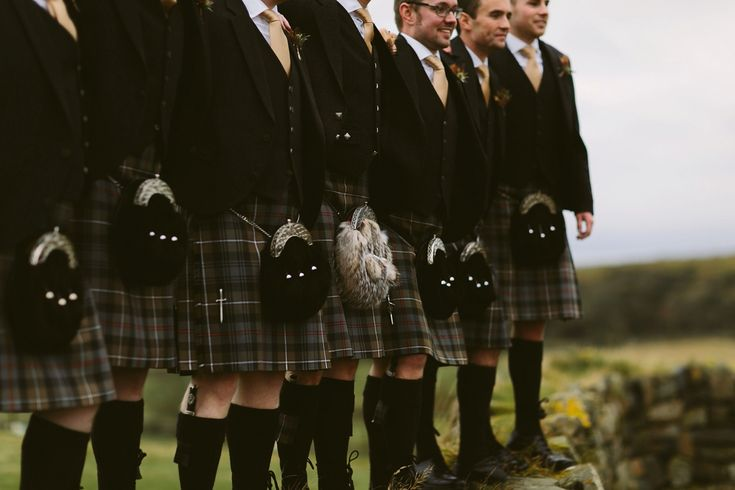 Groom and Groomsmen wear kilts for a wedding on the Scottish Coast. Photography Adam and Grace Photography