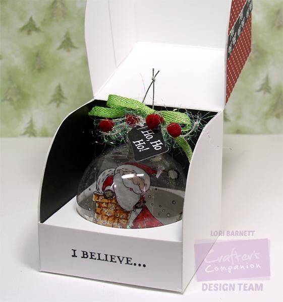 Fun box cut out by hand using the new Crafter's Companion Single Cupcake Presentation Box Template.  I made this to hold a fun ornament instead of a cupcake.  More info on my blog at http://loribarnett.blogspot.com/2014/12/i-believe.html