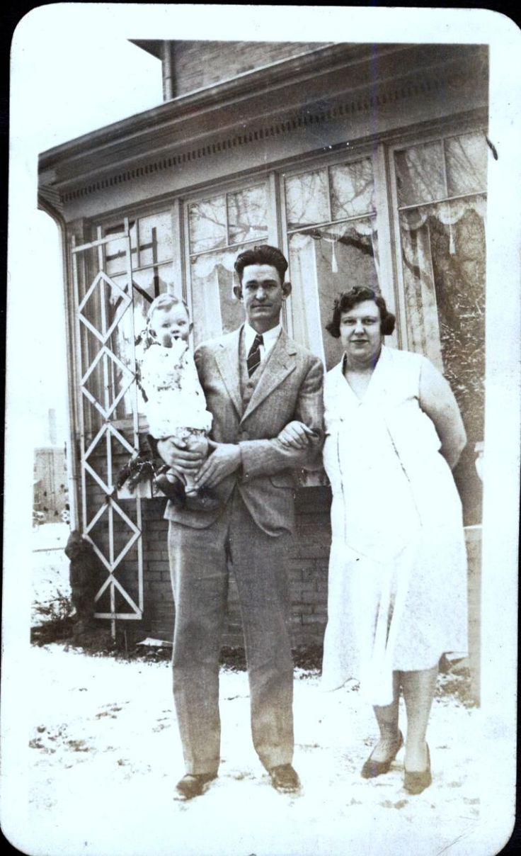 Thomas Allen Neal holding his son, Ronald Ord with wife Frances Albertine Curtis, Neal, about 1931, Denver, Colorado