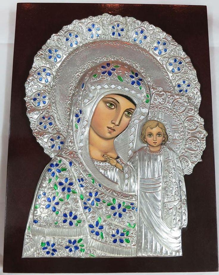 Virgen en repujado