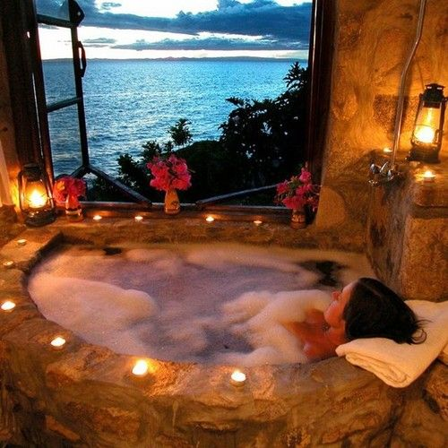 Aztec bathroom, Jacuzzi bath, candles lit and view of the ocean. Someone please take me there!
