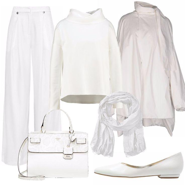 Un look morbido, confortevole, pratico. Ispirato un po' agli outfit tanto usati per praticare lo yoga: Morbidi pantaloni bianchi con maglietta a manica lunga con ampio collo. A completare il tutto, un cappotto che ricorda una mantella. Per uscire, una ballerina bianca in pelle, una sciarpa bianca e una borsa Gucci con dettaglio in coccodrillo.