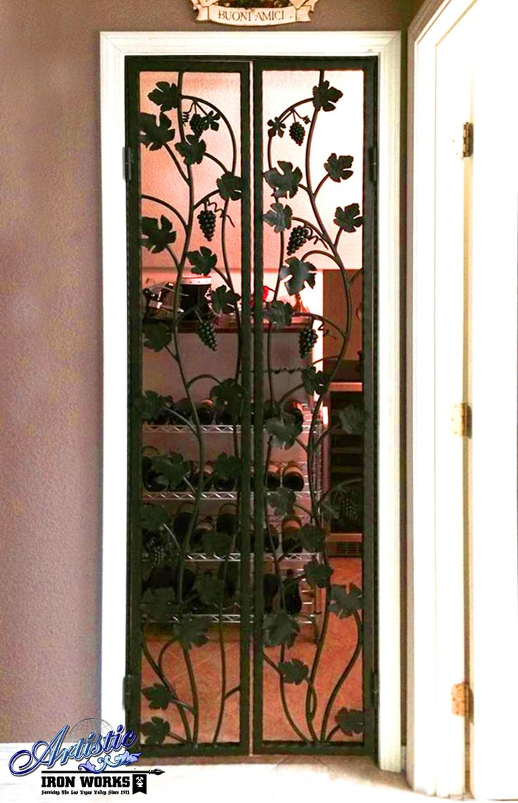 Wine Cellar Door With Grape Vines And Leaves Wrought Iron