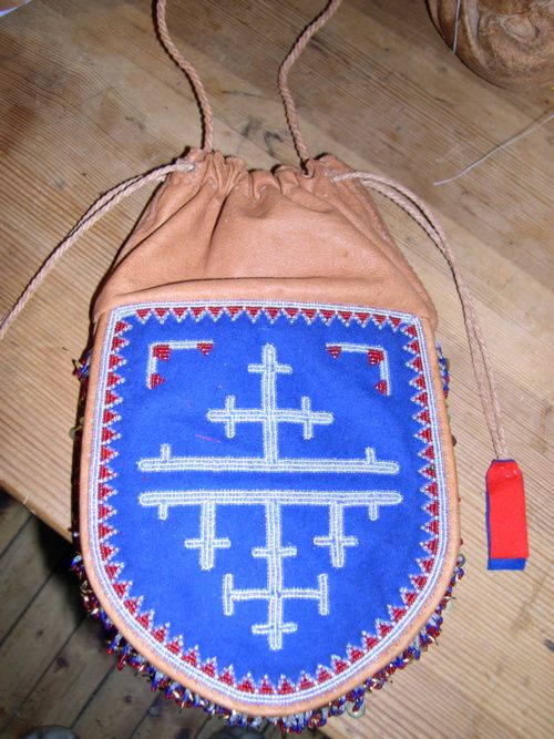 traditional beaded reindeer hide bag with beautiful posament decoration