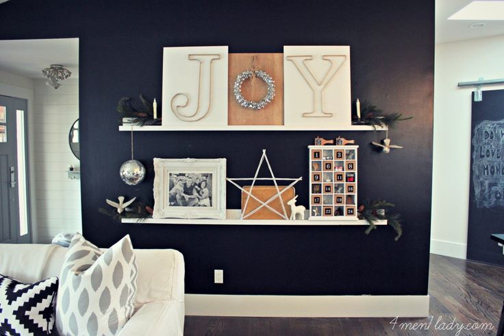 love this display....the black wall, white shelves, everything!