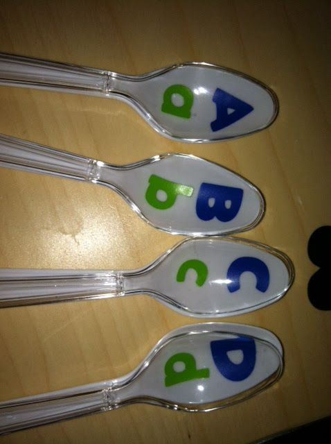 alphabet spoons... upper case on white spoon, lower case on clear; match them