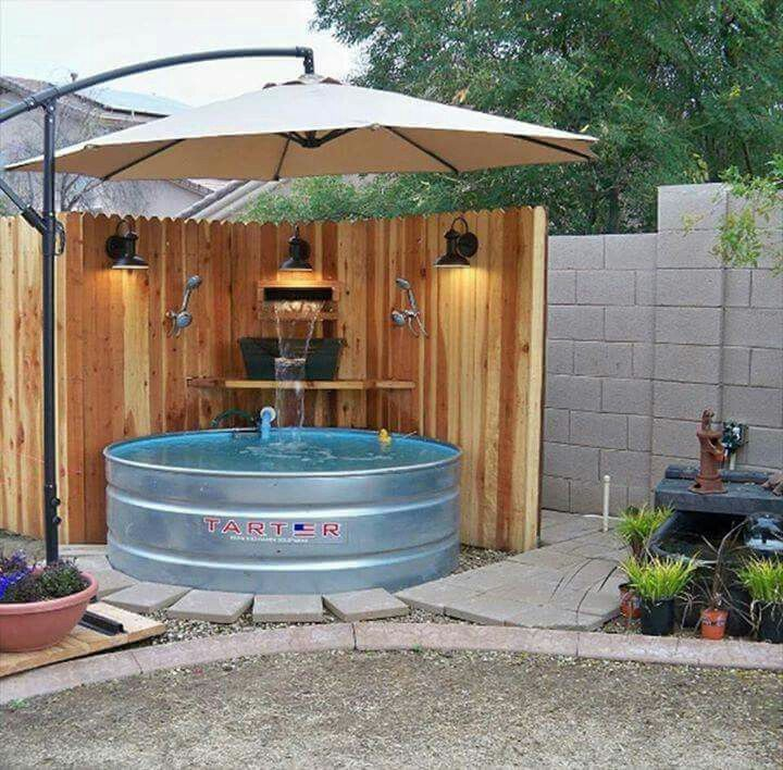 Outdoor leisure sitting pool with waterfall.  I like the wall and umbrella.  Nicely laid out.  my most popular pin.  every day for several months i get at least one repin but usually more.
