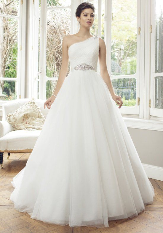 Popular Annabelle Tulle ball gown wedding dress with single shoulder neckline Bodice features diagonal ruching with jeweled detail Stain belt at the waist with
