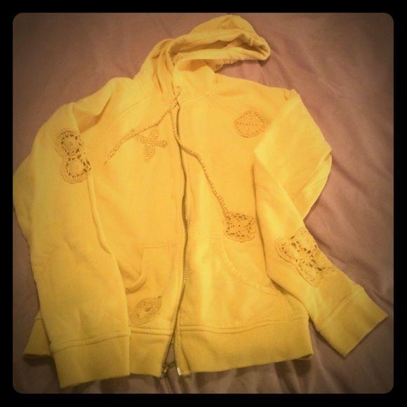 Crotchet and patches hoodie Beige zip-up hoodie with crotchet patches and patch of a bird on the front. Delias Tops Sweatshirts & Hoodies