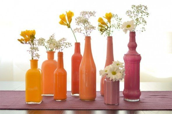 Playing with paint is super fun and can add some color to your place. Pour some paint inside glass vases, swirl it around, let it dry, and voila!