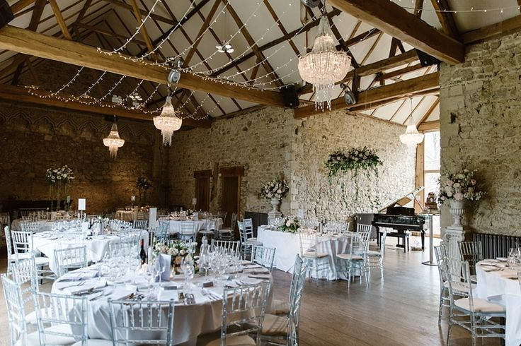 The Monks Refectory with fairy lights set up for a couple at Notley Abbey.  Flowers by Wild Orchid Designs.  Image by Natalie J Weddings