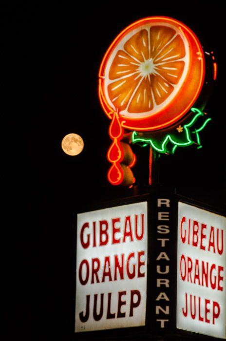 Moon rising against the Orange Julep sign