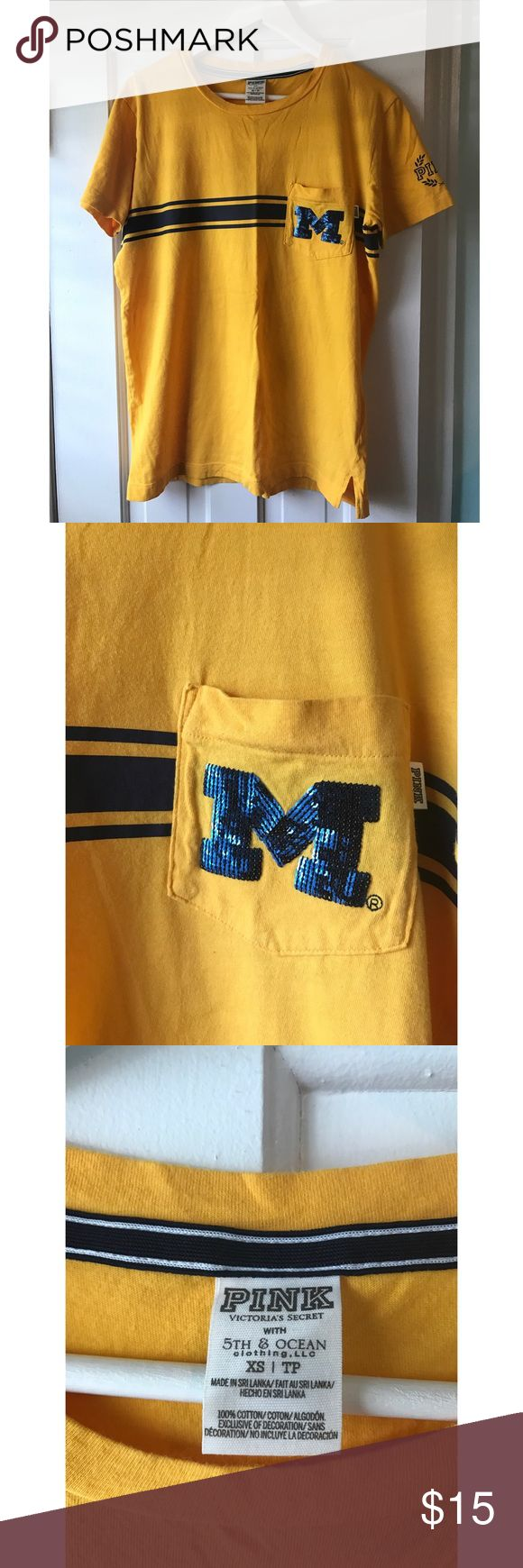 "PINK University of Michigan (U of M) Bling Shirt This is a University of Michigan Shirt by the brand PINK. It features a Bling ""M"" on the front. This shirt is in great condition. Perfect for game day. PINK Tops Tees - Short Sleeve"
