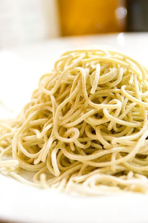 How to make homemade ramen noodles from scratch. These firm yellow Chinese style noodles are made with flour, kansui and water.