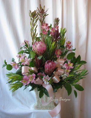 Protea, leucadendron, alstroemerias in pinks.