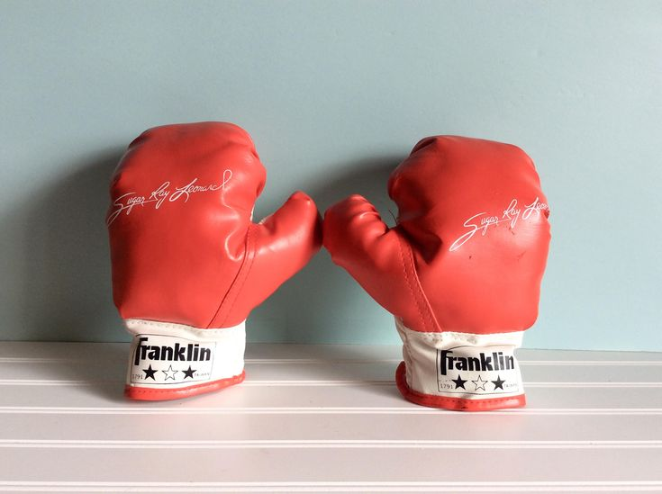 Excited to share the latest addition to my #etsy shop: Vintage Boxing Gloves, 1980's Sugar Ray Leonard Signature Youth Franklin Boxing Gloves, Collectible Sports Memorbilia, Boys Room Decor http://etsy.me/2HXWhhG #toys #red #birthday #christmas #white #boxinggloves #ol