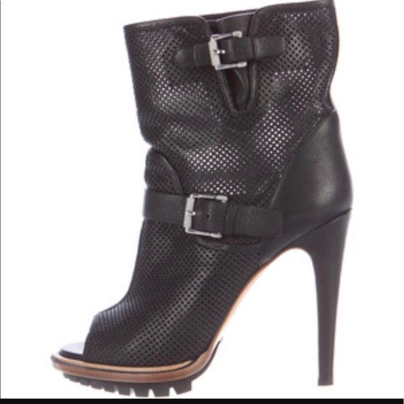 """Belstaff England Perforated Boots Belstaff England """"Croft"""" diamond-perforated calfskin leather black peep toe ankle boots. Adjustable straps at ankle and top line, silver tone buckles with signature knurled detail, gusset at top line, pebble leather-covered heel. Pull on. Leather and rubber lug sole. Made in Italy. 4.75"""" heel, 20 mm platform. Approx. 6"""" shaft. Brand new, never worn. Comes with dust bag. Size 37.5, best for US 7-7.5. Worn once, excellent condition. Belstaff Shoes Ankle Boots…"""