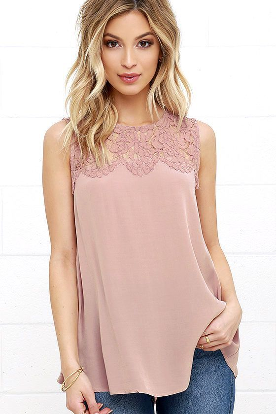Bring along the Place in the Sun Mauve Lace Top and watch as the sunshine follows! A lovely eyelash lace decolletage with scallop detail meets a breezy, Georgette bodice with flaring silhouette and rounded high-low hem. Mother of pearl button placket at back.