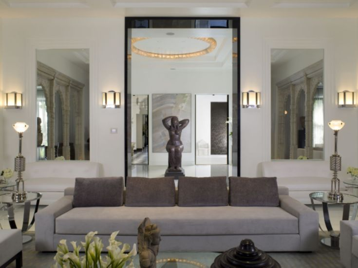 The Custom Living Room Sofa Wears Holly Hunt Ultrasuede With Pillows In Coordinating Lelievre