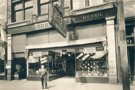 Pierre Paris, founder of the family shoe business, in front of the Paris Block at 51 West Hastings in the 1920s. The Strathcona Hotel is on the left. Vancouver Public Library VPL 84917