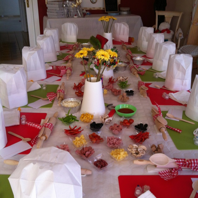 Chopped Jr. Birthday Party table decor idea - this is themed for pizza party, but I like the party hats and ingredients on the table.