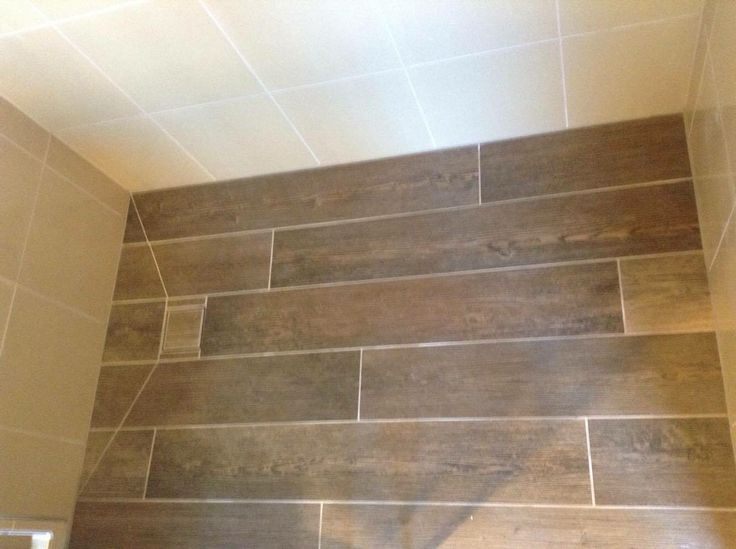 Timber tiles in a walk in shower base. From a recent bathroom renovation project.