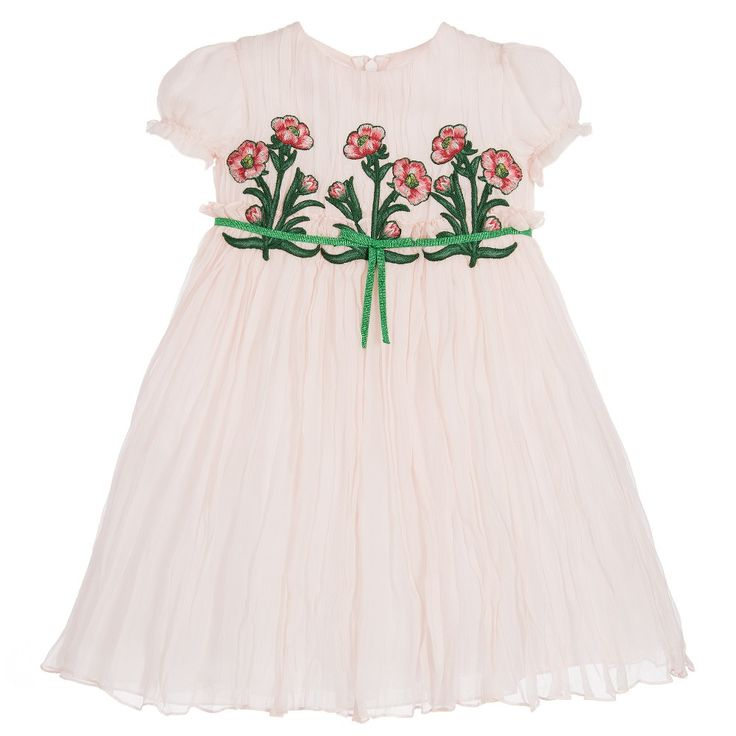 Baby girls pale pink dress by Gucci, made with gorgeous silk chiffon. The bodice is decorated with pretty red and green embroidered flowers. The skirt is gathered with a glittery green bow detail. The dress has a lightweight cotton lining with a zip to fasten at the back.
