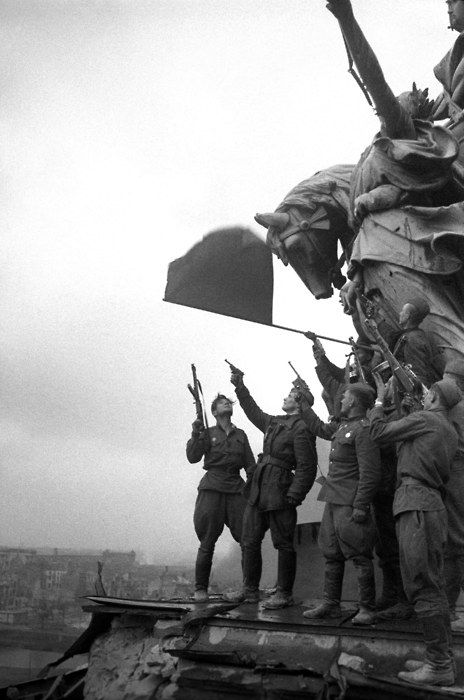 Red Army troops celebrating as their flag flies over Berlin.