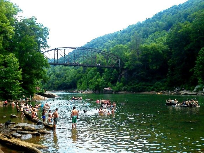 Blue Hole is located about 15 miles southeast of Morgantown, WV near Cooper's Rock State Forest. Its calm waters make it relatively safe for swimmers, as long as they don't jump from the bridge.
