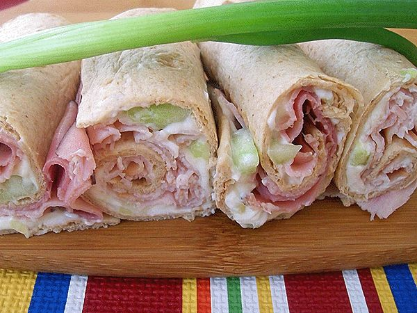 """Turkey and Ham Wraps with Cucumber Cream Cheese recipe. Slice into """"pinwheels"""" to make an easy appetizer."""