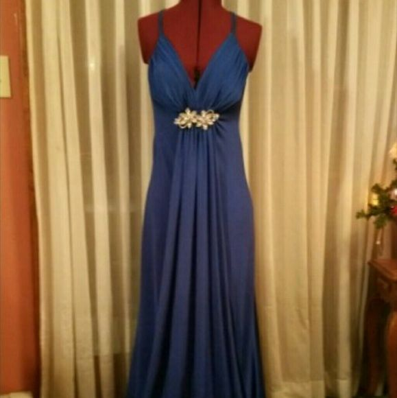 Royal Blue Prom Dress Criss cross spaghetti straps in back of dress  Low open back with a half zip Padding in bra but can be removed if not needed Deep V neckline that draws your eye down to the rhinestone pin to give this dress an elegant but sophisticated feel.  Overlay flap in front of dress that runs from the pin to the floor Great for hiding a bloated tummy.  Very comfortable on.  Beautiful dress that can have so many wears. Thea Dora Dresses Maxi