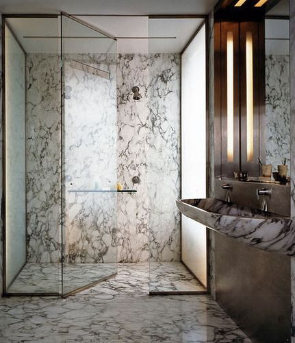 satin brass shower detailing, and look at that marble with the etched glass…