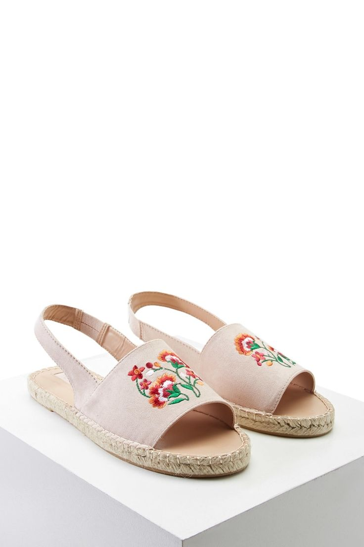 A pair of faux suede espadrilles featuring top floral embroidery, a sling back, open toe, and a braided sole.