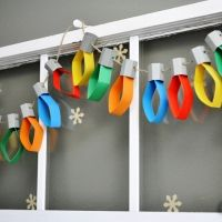we used toilet paper rolls painted grey and cut in thirds for the base of the bulbs.