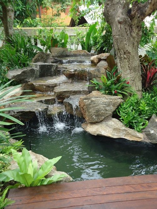 The relatively large stones used in this waterfall give a natural look. This could be softened with the addition of smaller pieces or pebbles amongst the crevices, edges and joints.
